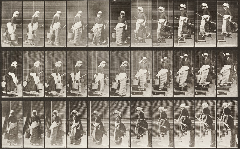 Woman descending stairs, turning and carrying a bucket of water and a broom (Animal Locomotion, 1887, plate 148)