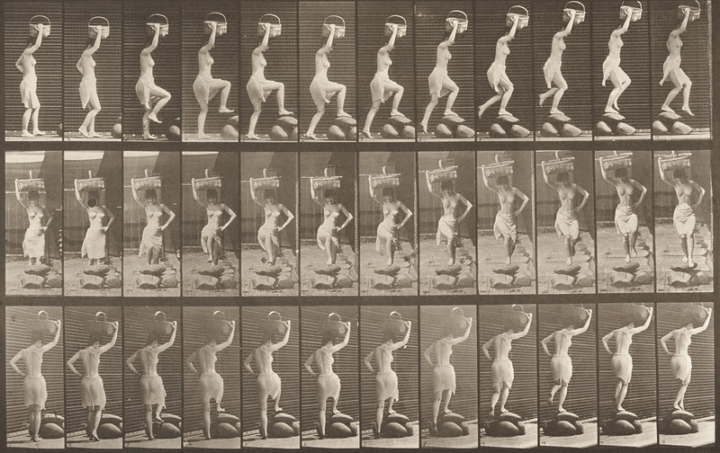 Semi-nude woman stepping on and over a rock holding a basket on her head with the right hand raised (Animal Locomotion, 1887, plate 179)