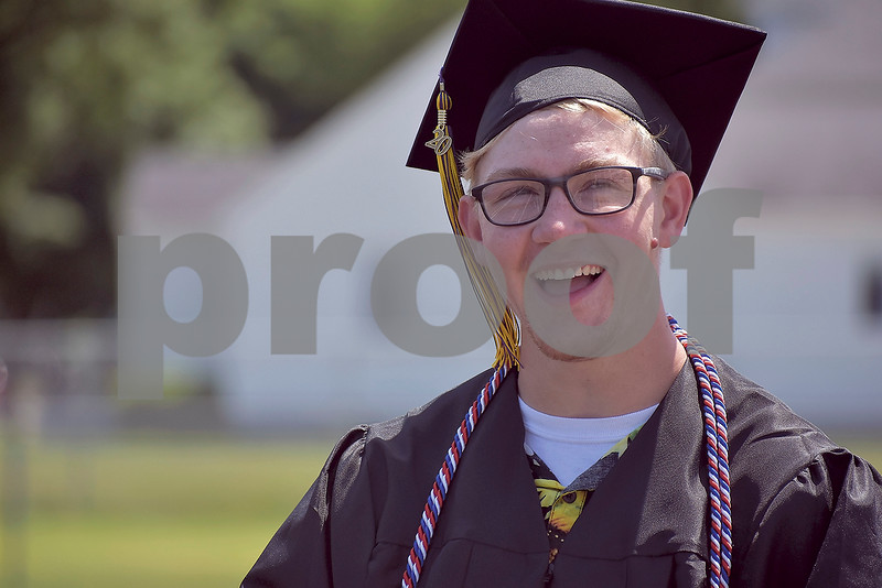 -Messenger photo by Chad Thompson<br /> <br /> Mark Dawson smiles as he looks toward the crowd gathered at the Eagle Grove High School football field for the class of 2020 graduation ceremony on Saturday.