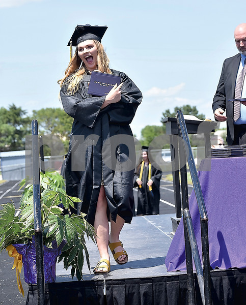 -Messenger photo by Chad Thompson<br /> <br /> Kaitlynn Ferry shows off her high school diploma at the Eagle Grove High School graduation ceremony on Saturday.