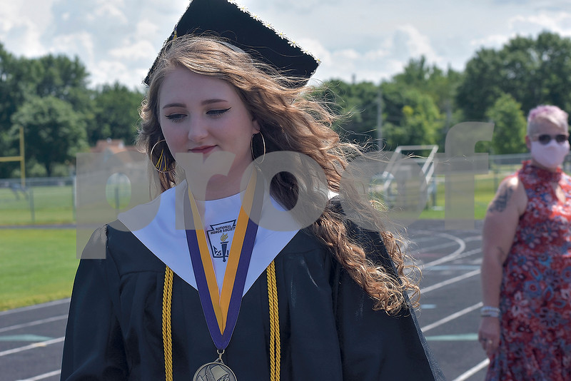 -Messenger photo by Chad Thompson<br /> <br /> Briauna Mingus makes her way across the track on the Eagle Grove High School football field for the class of 2020 commencement on Saturday. Mingus was the class salutatorian.