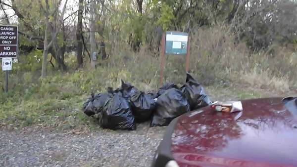 Ten large bags of trash (150 ~ 200 lbs) from 2 canoes & 2 kayaks!