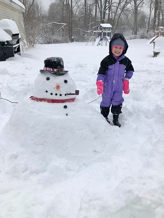 Jill St. John shared this photo of her daughter and a snow friend.