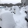 "Joe Rogge of Adams sent this ""after"" pic of his snowmobiles covered with the white stuff."