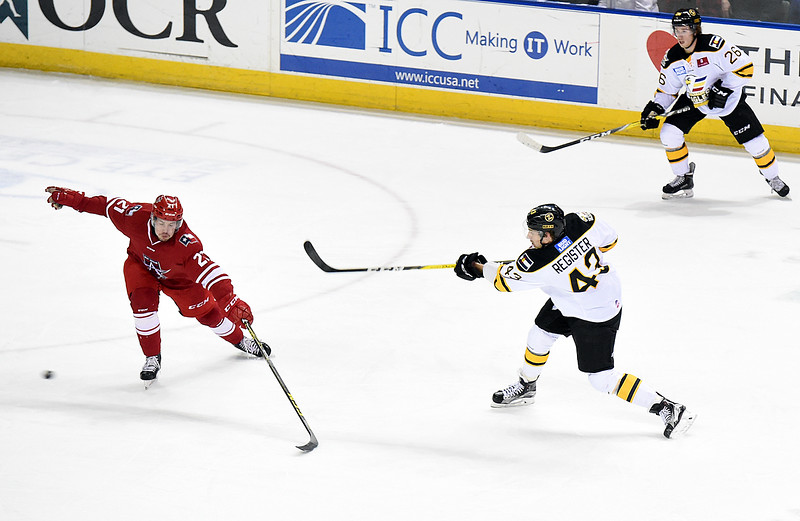 Colorado Eagles #43 Matt Register takes a shot as Allen Americans #21 Chris Crane tries to block during their game on Wednesday, Nov. 9, 2016, at the Budweiser Event Center in Loveland. (Photo by Jenny Sparks/Loveland Reporter-Herald)
