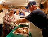 HOLLY PELCZYNSKI - BENNINGTON BANNER Steve Bessette, serves Turkey to Polly Lemoire on Wednesday morning at the Eagles Aeire in Bennington.