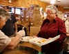 HOLLY PELCZYNSKI - BENNINGTON BANNER Peg Stevens of Bennington fills her plastic foam plate with turkey, mashed potatoes, gravy, and all the fixings on Wednesday morning at the Eagles Aerie in Bennington.