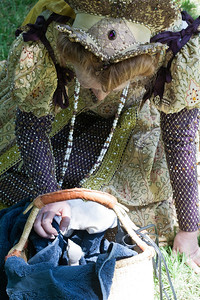 May 12, 2011: Queen Elizabeth with the baby Lanner falcon.