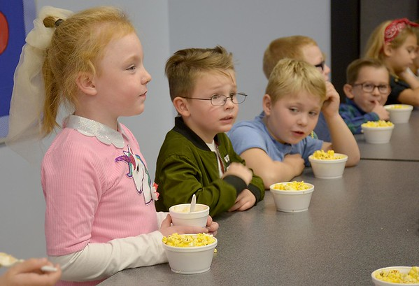 Kindergartners at the Early Learning Center snack on popcorn and root beer floats during the Early Learning Center's 1950s-themed Halloween celebration Thursday. Kaitlin Cordes photo