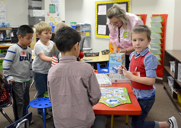 A group of boys play a variety of games during the Early Learning Center's 1950s-themed Halloween celebration Thursday. Kaitlin Cordes photo