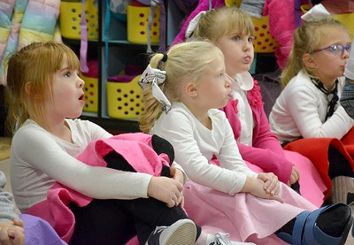Kindergartners, from left, Karlee Czyzewski, Mackenzie Davis, Isabella Starr and Lydia Wendling do their best to blow the biggest bubble gum bubble during the Early Learning Center's 1950s-themed Halloween celebration Thursday. Kaitlin Cordes photo