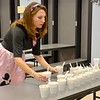 Early Learning Center Principal Jennifer Fox serves root beer floats during the ELC's 1950s-themed Halloween celebration Thursday. Kaitlin Cordes photo