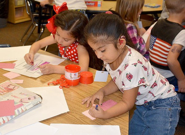 Two kindergartners color during the Early Learning Center's 1950s-themed Halloween celebration Thursday. Kaitlin Cordes photo