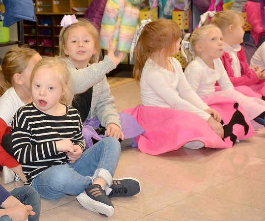 Girls in poodle skirts try their hand at a bubble gum blowing contest during the Early Learning Center's 1950s-themed Halloween celebration Thursday. Kaitlin Cordes photo