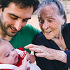 Family emotional moment of a father with his baby and his grandmother