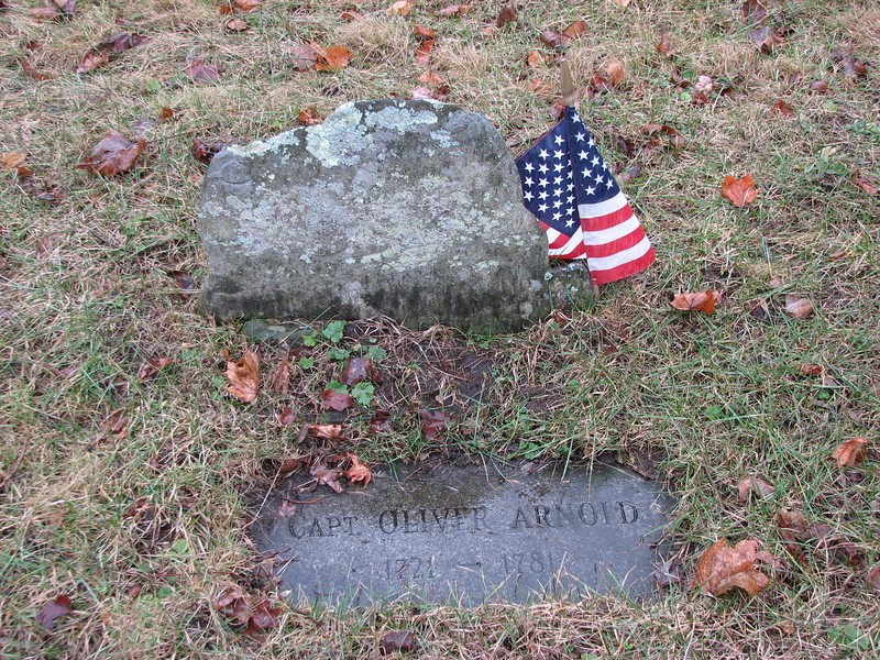 Grave of Oliver Arnold. To locate the grave, enter the cemetery and follow the main path, which dips. At the lowest point, the grave will be about 30 feet away on your right.