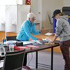Early voting for the 2016 presidential election started on Monday. On Tuesday it was still going strong in North Central Massachusetts. An election worker explains the ballot to Whitney Mansfield, 20, at the polls in Lunenburg Town Hall. SENTINEL & ENTERPRISE/JOHN LOVE