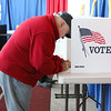 Raymond Sawtelle votes during the early voting in Fitchburg on Tuesday. SENTINEL & ENTERPRISE/JOHN LOVE