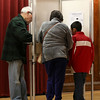 Early voting for the 2016 presidential election started on Monday. On Tuesday it was still going strong in North Central Massachusetts. Edrei Cantillano, 8, learns about voting from his grandparents Jorge and Carmen Belardo at the early voting in Leomister City Hall on Tuesday. SENTINEL & ENTERPRISE/JOHN LOVE