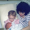 """March 1990, 23 months. Casey meets baby brother Brett for the first time.<br /> <br />  Brett had cradle cap. When Casey looked at his head she said, """"Mommy, he has head buggies!"""""""