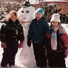 Rachel Pacifico (left), Casey and Gina Corrato building a snowman in  the Pacifico's backyard.