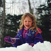 """Feb. 1994, almost 6 yrs. old. Casey playing in the snow and enjoying an ice """"pop""""."""