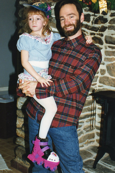 Casey with her daddy. She had just been roller blading in the house.