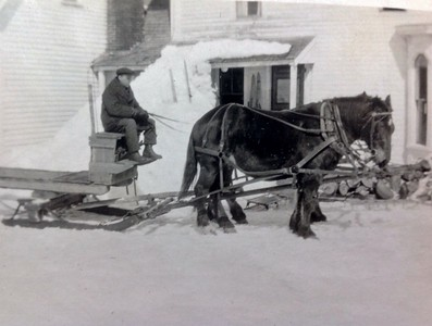 Horse drawn sled in front of Stone farmhouse, 1928