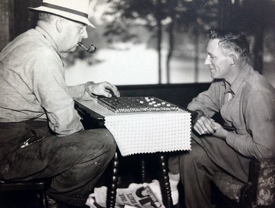 Frank Stone playing checkers with friend, 1937