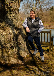 Lisa leaning on the willow tree