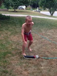 Conall's overtired sprinkler dancing!