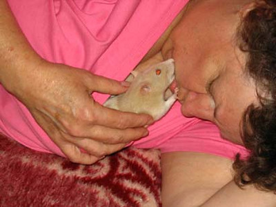 """Dianne Hammond and her precious Rosie snuggle together, from several years ago. """"She was an amazing little lady."""""""