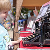 4/23/16 TOWNSEND-- Mason Perry, 5, of Townsend looking at a typewriter that was once owned by the family of E.B. White.  The Typewriter was displayed on Saturday at the 2016 Earth Day Celebration in Townsend. (Photo/Jeff Porter)