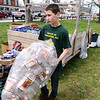 2/23/16 TOWNSEND-- Dominic Capone, 14, of Townsend removing full bags of bottle's from the bottle drop off area to make space for incoming recyclables at the 2016 Earth Day Celebration in Townsend. (Photo/Jeff Porter)