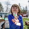 4/23/16 TOWNSEND-- Leeann Congdon, 5, from Townsend handing out stickers to promote the 4-H Club of Townsend on Saturday at the annual Earth Day Celebration held on the Townsend Common. (Photo/Jeff Porter)