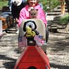 Kristi Garabrandt - The News-Herald <br> Terri Pennza, Kirland and Mila Gravens prepare to ride the trains Orchard railroad during Lake Metroparks Earth Day celebration.