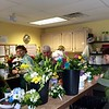 The Power of Flowers Project workshop was humming on Earth Day as volunteers made arrangements. Photo by Mary Leach