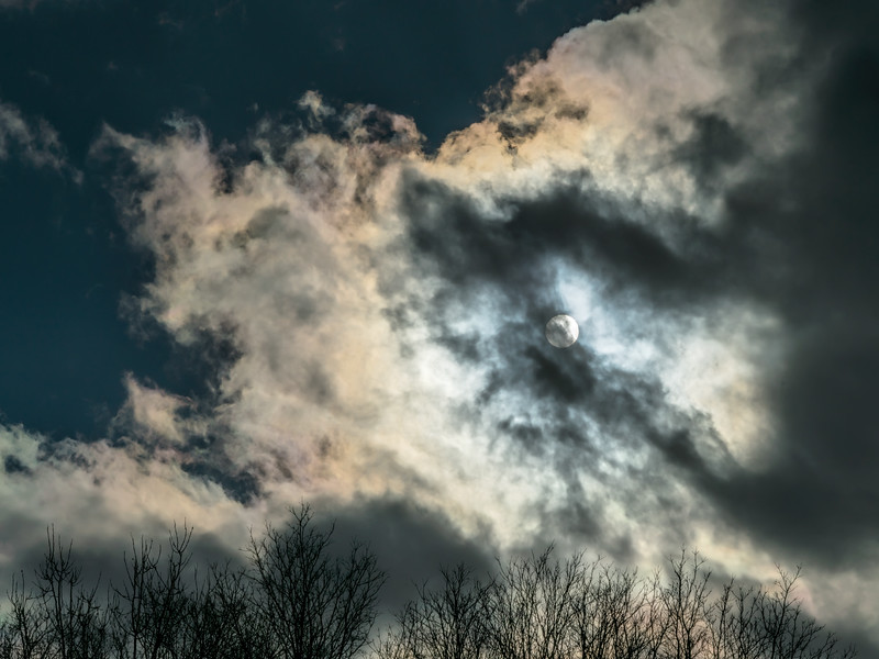 Featured:  Faux moon, faux storm, genuine color in the clouds
