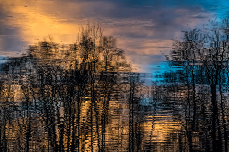 Reflections of a sunrise tinted sky