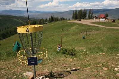 BEAVER CREEK, CO - Jordan makes a shot for Hole 4 on the Disc Golf course.