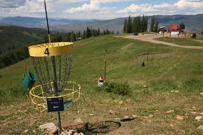 BEAVER CREEK, CO - Jordan makes a shot for Hole 4 on the Disc Golf course.