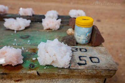 HENTIESBAAI, NAMIBIA - Just north of Swakopmund, salt crystals are for sale along the side of the road. Using the honor system, money is deposited in the can for purchases and collected at the end of the day.