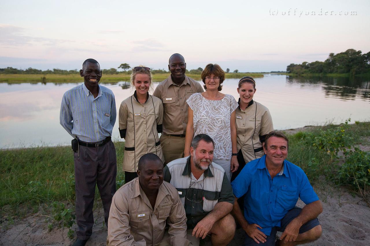 HORSESHOE BEND, KWANDO RIVER, NAMIBIA - Sundowner (sunset drinks) hosted by Susuwe Island Lodge with elephants, hippos, baboons and impala all sharing the beach.