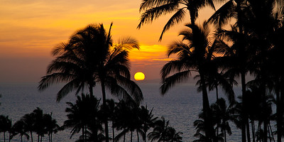 """Maui Sunset"", The sun slips behind the tip of the island. format 2:1"