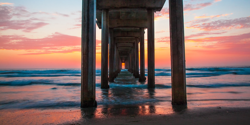 """Scripps Pier Sunset"", the sun sets in line with the pier"