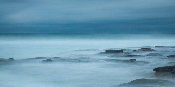 High tide at the La Jolla tide pools. Long exposure showing the water movement.