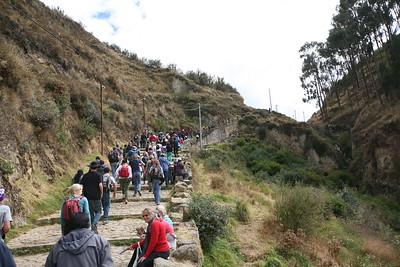 SAQUSAYWAMAN, CUSCO, PERU - Walking up to the park.