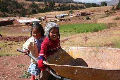 MISKIUNO, CUSCO, PERU - The kids are ready to help.