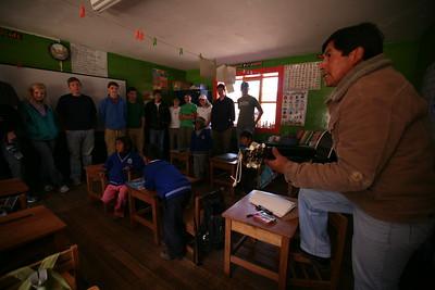 PUMAMARKA, CUSCO, PERU - Classroom visit. The teacher sings the visitors a song.