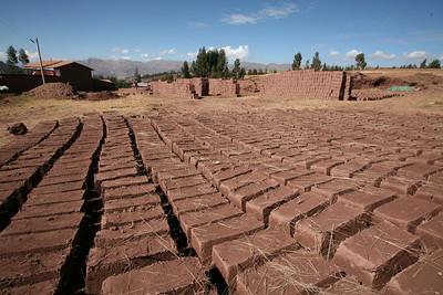 PUMAMARKA, CUSCO, PERU - Adobe bricks drying.